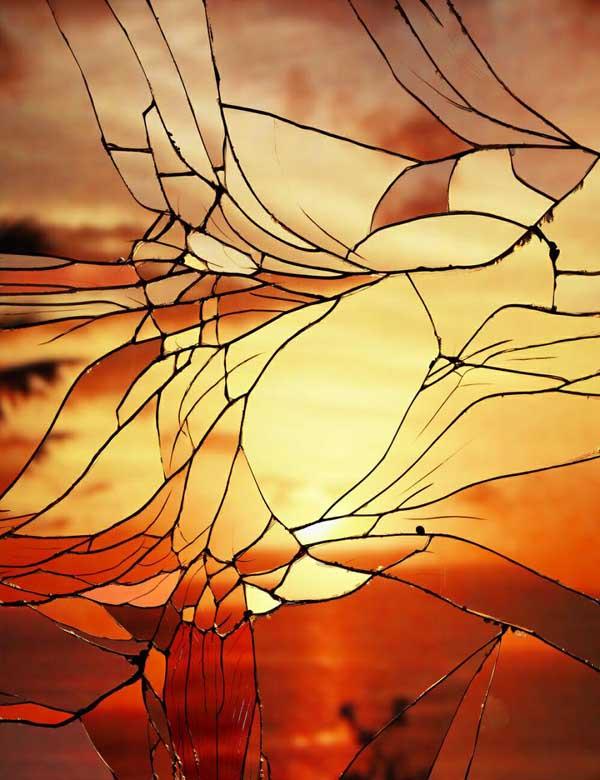 gambar sunset di balik kaca pecah